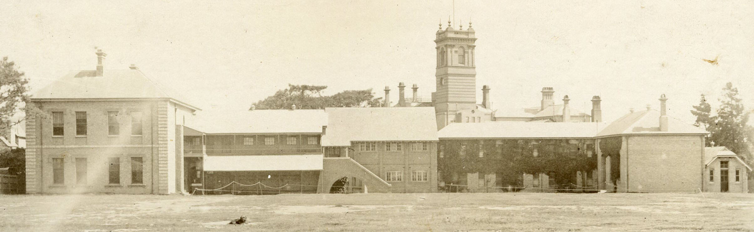 Banner photo - school buildings and oval 1910