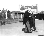 Two masters walking across the main quad, Speech Day, c1940.